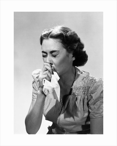 1950s Woman Eyes Closed With Cold Sneezing Into Handkerchief by Corbis