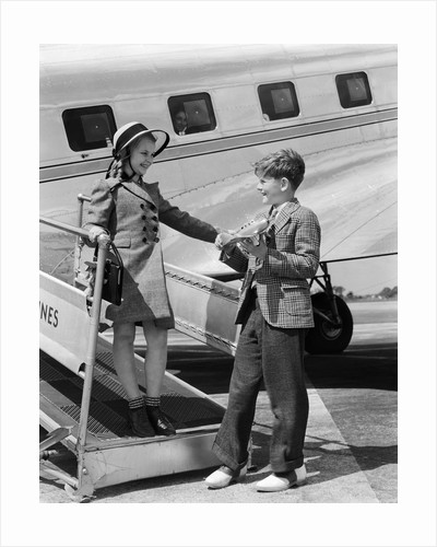 1940s Boy Girl Walking Off Boarding Ramp Of Airplane Boy Holds Toy Plane Dress Fashion Suit Tie by Corbis