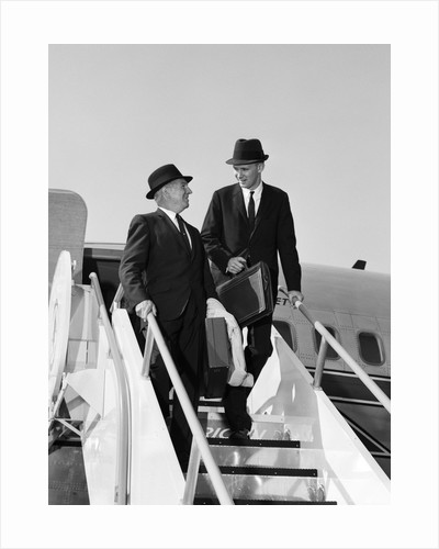 1960s Two Business Men Briefcase Exit Airplane Steps by Corbis