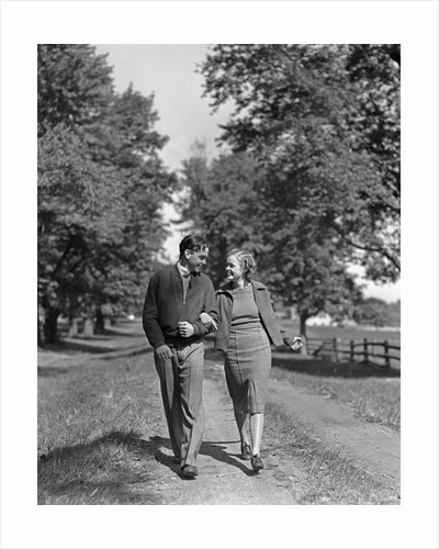 1930s 1940s Young Teen Couple Boy Girl Strolling Down Autumn Country Lane Arm In Arm by Corbis