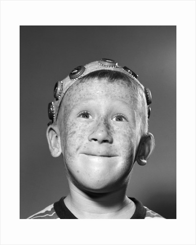 1950s Portrait Of Freckled Teen Boy Wearing Bottle Cap Beanie by Corbis