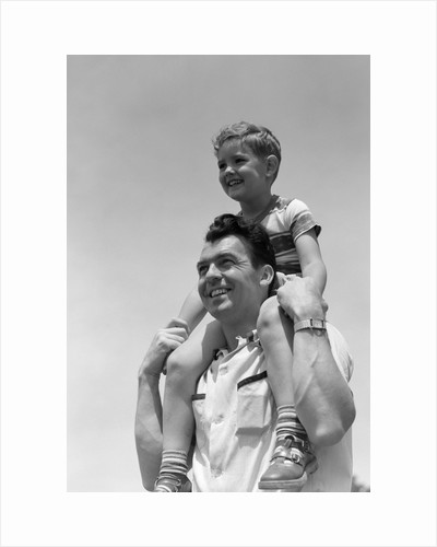 1950s Father Carrying Son On Shoulders Outdoor by Corbis