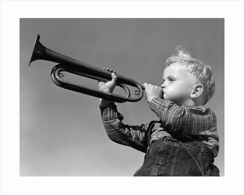 1940s Boy Blowing Bugle Outdoor by Corbis