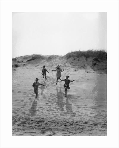 1920s 4 Kids 2 Boys 2 Girls Running Down Sand Dune by Corbis