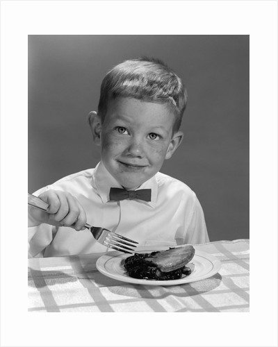 1960s Boy Wearing Bow Tie Eating Pie Dessert With Fork by Corbis