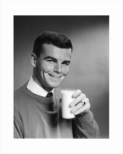 1960s Young Man Holding Glass Of Milk by Corbis