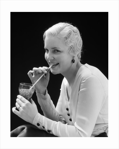 1930s Woman Drinking Soda With A Straw by Corbis