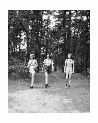1940s Three Young Women Walking In Woods Hiking by Corbis
