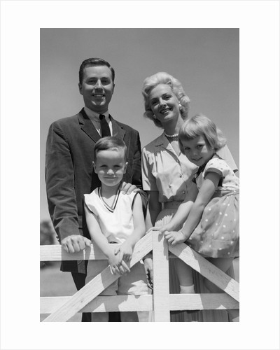 1950s 1960s portrait family father mother son daughter behind white fence outdoor by corbis