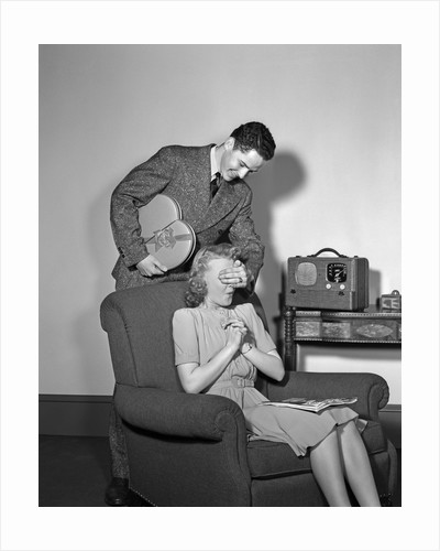 1940s Teen Couple Boy With Hand Over Girl Eyes Surprising Her With Box Of Valentines Day Candy by Corbis