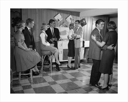 1950s 1960s Teen Couples Having Party Dancing In Rec Room by Corbis