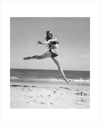 1950s Woman In Bikini Running And Jumping On The Beach Smiling by Corbis