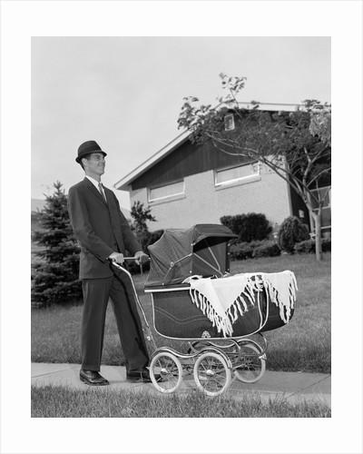 1960s Man Pushing Stroller Baby Carriage Suburban Sidewalk by Corbis