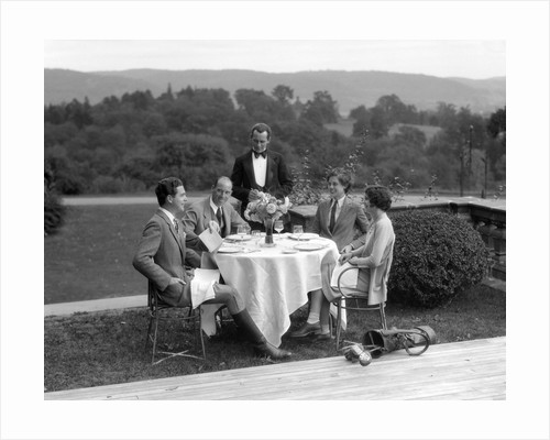 1920s 1930s Country Club Scene With Two Couples With Golf Clubs Having Lunch Outdoors by Corbis