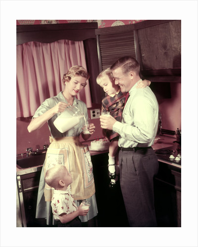 1950s Family In Kitchen Mother Pouring Milk From Pitcher For Dad And Kids by Corbis
