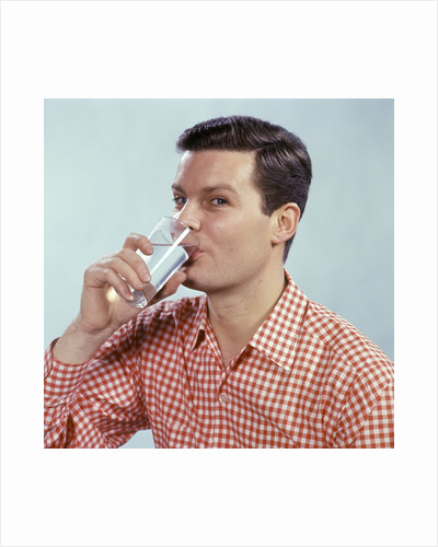 1960s Man Drinking Glass Water Wearing Red Checkered Shirt by Corbis