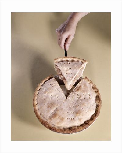 1970s Hand Serving Wedge Slice Of Apple Pie by Corbis
