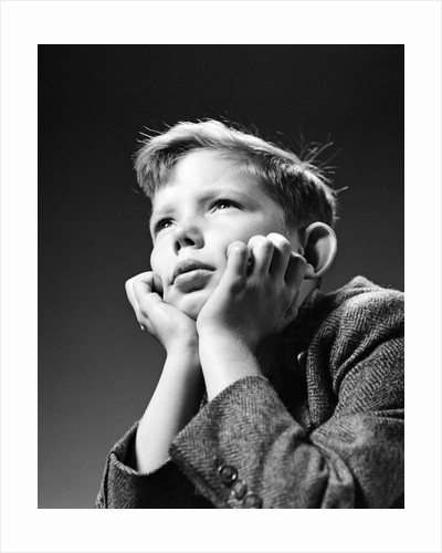 1940s Bored Serious Boy Waiting Chin Resting In Hands by Corbis