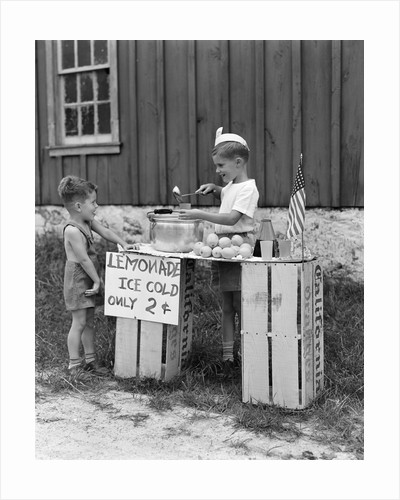 1930s 1940s Boy With Lemonade Stand Selling To Little Boy In Short Pants by Corbis