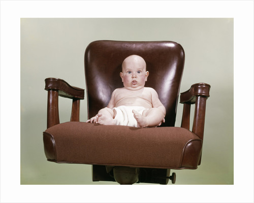 1960s Chubby Bald Baby Wearing Cloth Diaper Sitting In Executive Office Business Chair by Corbis