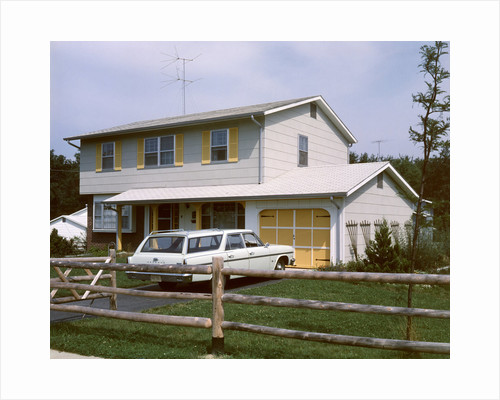 1960s 1970s Suburban Home Two Story With Station Wagon In Driveway by Corbis