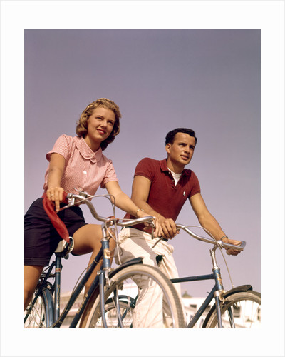 1950s 1960s Couple Man Woman Riding Bicycles Outdoors by Corbis