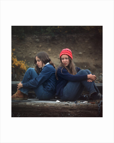 1970s Two Sad Serious Teenage Girls Sitting Back To Back Outside by Corbis