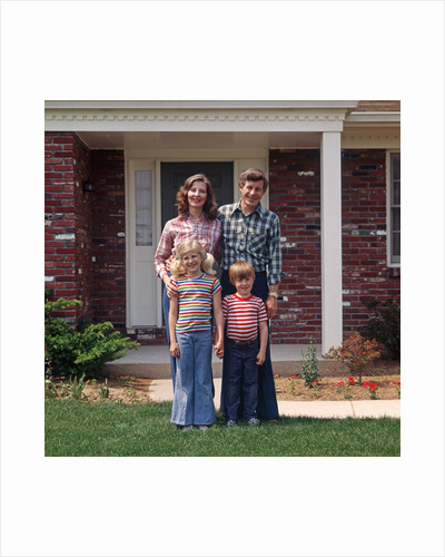 1970s Family Posing On Front Lawn Outside House by Corbis