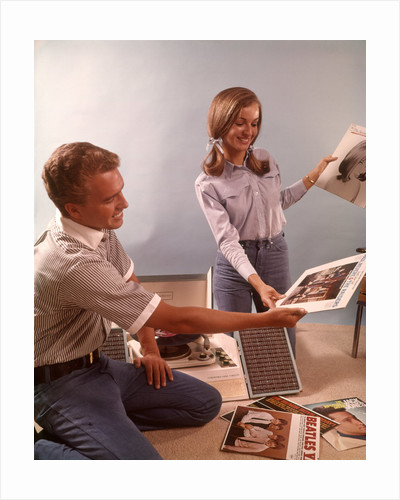 1960s Teenage Couple Boy Girl Sorting Listening To Vinyl Record Music Albums by Corbis