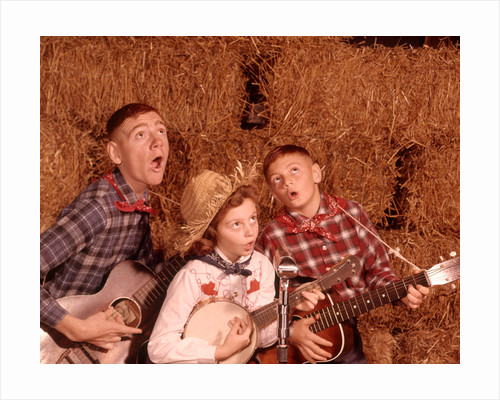 1950s 1960s Two Brothers And A Sister Playing Instruments Guitars And Banjo Singing Country Music by Corbis