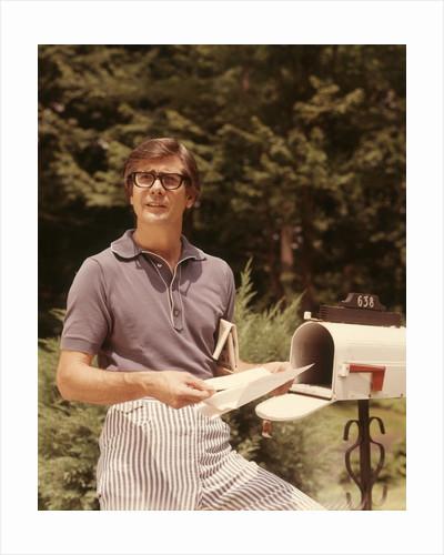 1970s Man In Casual Blue Stripe Seersucker Pants Taking Mail by Corbis