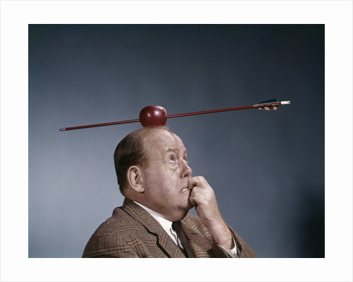 1960s Anxious Business Man Biting Finger With Nails Arrow Shot Through Apple On Of His Top Head by Corbis