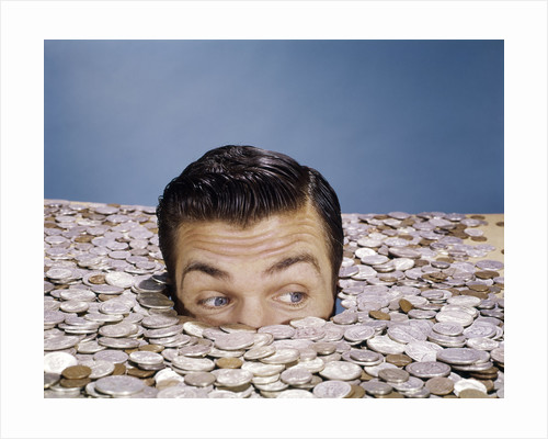 1960s Top Of Head And Eyes Of Man Looking Out From Pile Of Coins Studio Symbolic Currency by Corbis
