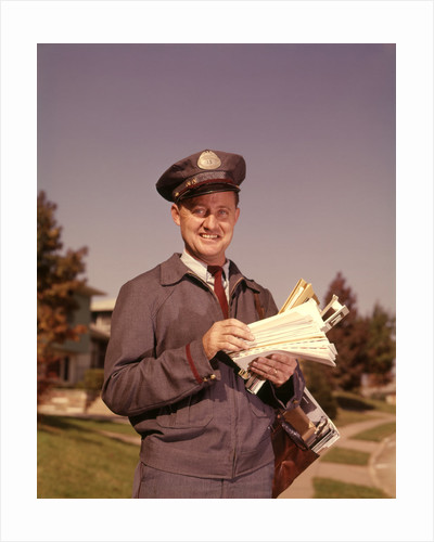 1960s Mailman Holding Letters Mail Leather Mailbag In Suburban Neighborhood by Corbis