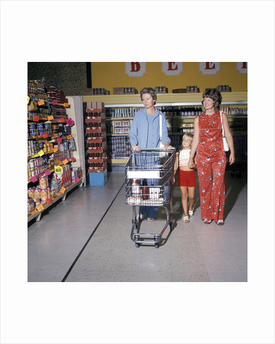 1970s Two Women Small Girl Walking Down Supermarket Grocery Store Aisle Woman Pushing Cart by Corbis