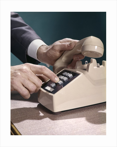 1960s 1970s Man Hands Businessman Salesman Dialing Touch Tone Telephone by Corbis