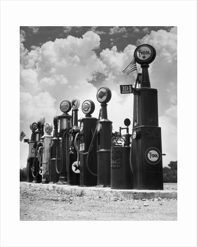 1920s 1930s Line Of Gasoline Pumps by Corbis