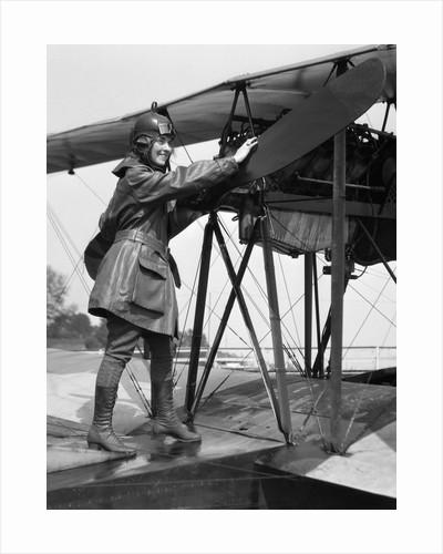 1920s Woman Aviator Turning Float Biplane Propeller by Corbis