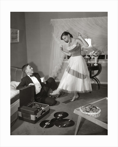 1950s 1960s Teen Couple Dressed for Prom, Girl Dancing To Music From A Record Player by Corbis
