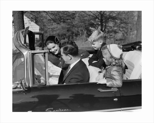 1950s Family Father Mother Daughter Son In Convertible Reading Map by Corbis