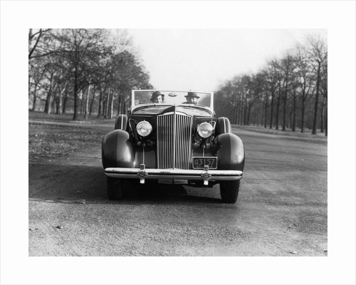 1930s 1935 Couple Driving Packard Convertible Automobile by Corbis