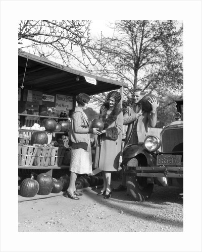 1920s Couple Women Man At Roadside Produce Stand Buying Pumpkins by Corbis