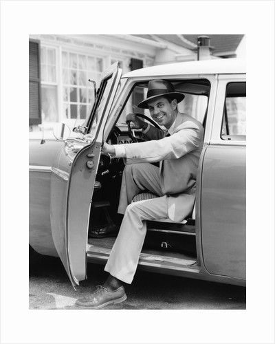 1950s Man Holding Car Door Open by Corbis