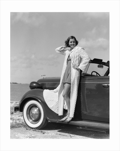 1930s 1940s Woman Wearing Chenille Beach Robe Posing On Running Board Of Convertible Roadster Automobile by Corbis