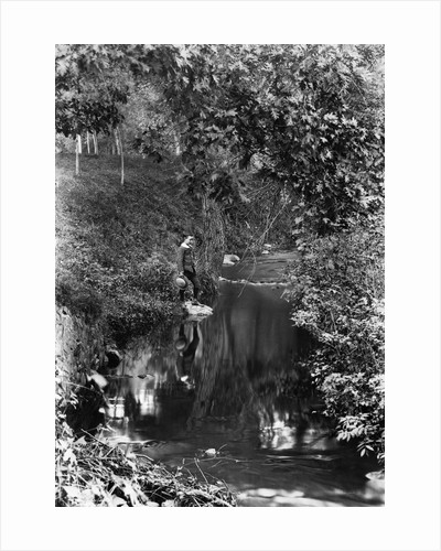 1890s 1900 Boy Standing In Wooded Area Looking Down At Reflection In Creek by Corbis