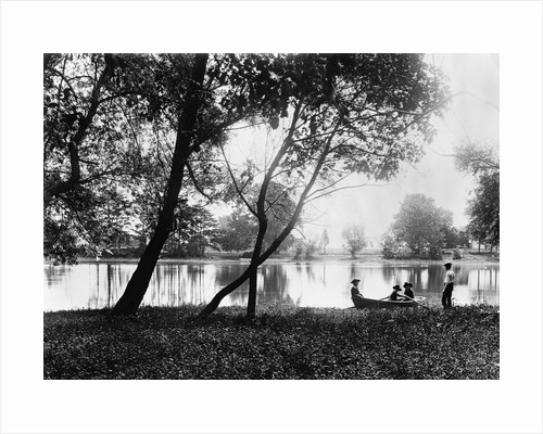 1890s 1900 Older Brother Watching Three Younger Children In Rowboat On Small Lake by Corbis
