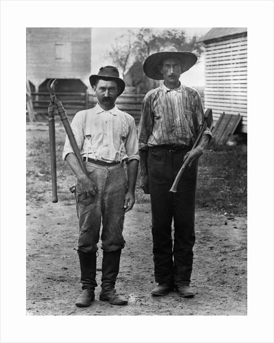 1890s 1900s 2 Men On Farm In Work Clothes One Holding Pruner and One Holding Ax by Corbis