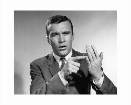 1950s Earnest Salesman Talking Gesturing With Hands by Corbis