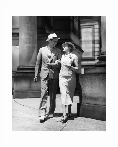1930s Couple In Suits And Hats Walking Arm In Arm by Corbis