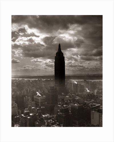 1930s 1940s Empire State Building New York City In Storm Cloud Cover by Corbis